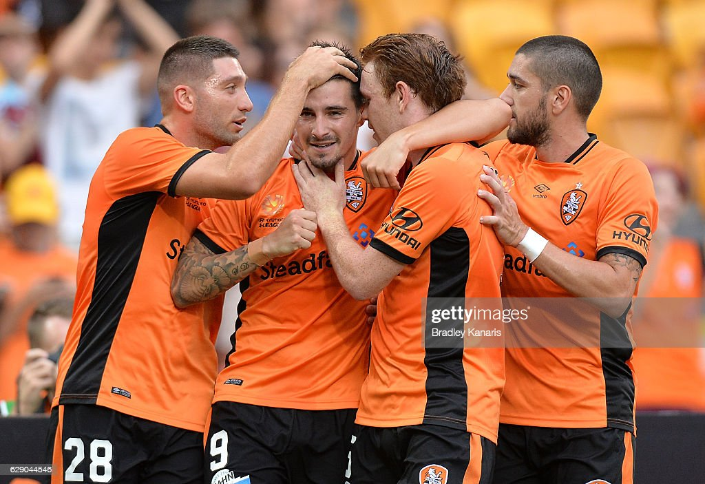 Jamie Maclaren of the Roar is congratulated by team mates after scoring a goal during the round 10 A-League match between the Brisbane Roar and Adelaide United at Suncorp Stadium on December 11, 2016 in Brisbane, Australia.
