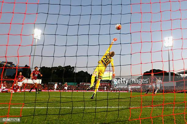 Jamie Maclaren of the Roar scores a goal past Wanderers goalkeeper Andrew Redmayne during the ALeague Semi Final match between the Western Sydney...