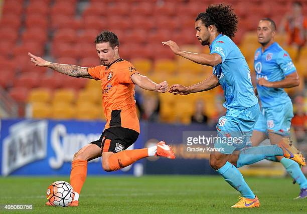 Jamie Maclaren of the Roar takes a shot at goal during the round four ALeague match between Brisbane Roar and Adelaide United at Suncorp Stadium on...