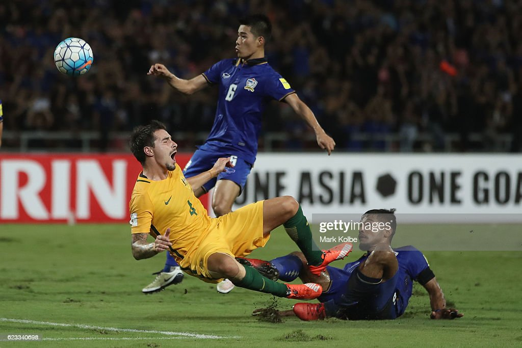 Jamie Maclaren of the Socceroos lands awkwardly after a heavy tackle from Prathum Chuthong of Thailand during the 2018 FIFA World Cup Qualifier match between Thailand and the Australia Socceroos at Rajamangala National Stadium on November 15, 2016 in Bangkok, Thailand.