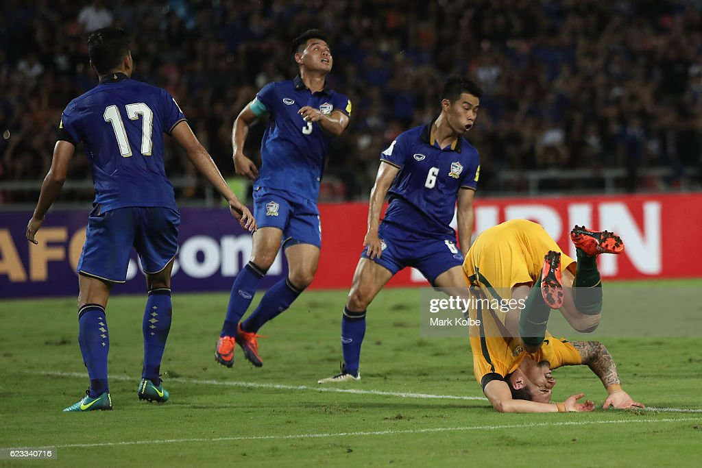 Jamie Maclaren of the Socceroos lands awkwardly after a heavy tackle during the 2018 FIFA World Cup Qualifier match between Thailand and the Australia Socceroos at Rajamangala National Stadium on November 15, 2016 in Bangkok, Thailand.