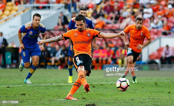 Jamie Maclaren scores from the penalty spot during the round 14 ALeague match between the Brisbane Roar and the Newcastle Jets at Suncorp Stadium on...