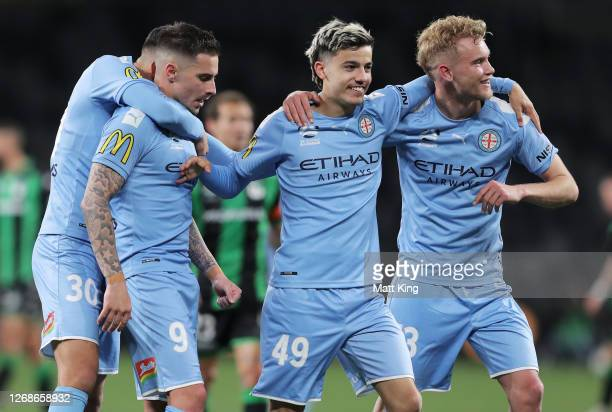 Jamie Maclaren, Stefan Colakovski and Nathaniel Atkinson celebrate victory at full-time during the A-League Semi Final match between Melbourne City...