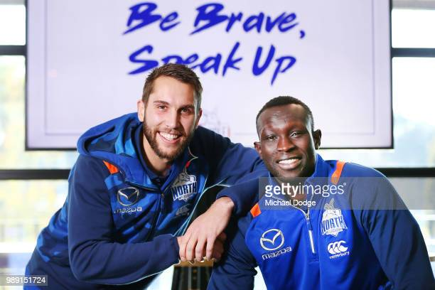 Jamie Macmillan and Majak Daw of the Kangaroos pose during a North Melbourne Kangaroos AFL media opportunity at Arden Street Ground on July 2, 2018...