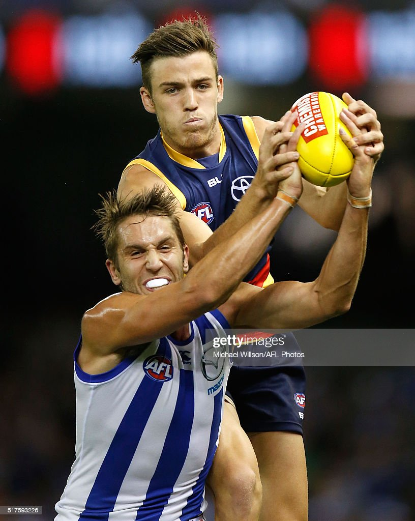 Jamie Macmillan of the Kangaroos and Paul Seedsman of the Crows compete for the ball during the 2016 AFL Round 01 match between the North Melbourne Kangaroos and the Adelaide Crows at Etihad Stadium, Melbourne on March 26, 2016.