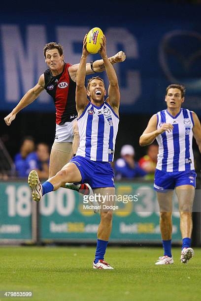Jamie Macmillan of the Kangaroos marks the ball against Jake Carlisle of the Bombers during the round one AFL match between the North Melbourne...
