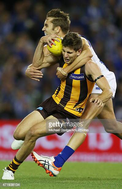 Jamie Macmillan of the Kangaroos tackles Luke Breust of the Hawks during the round five AFL match between the North Melbourne Kangaroos and the...