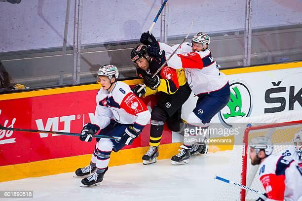 Jamie Macqueen of Eisbaren Berlin hits Matti Jarvinen of SaiPa Lappeenranta during the Champions Hockey League match between SaiPa Lappeenranta and...