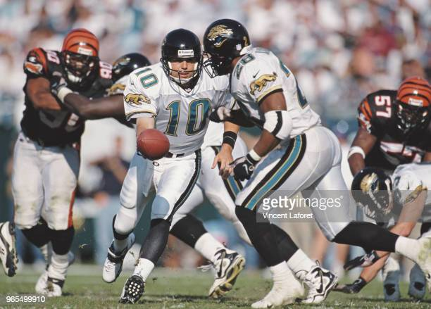 Jamie Martin Quarterback for the Jacksonville Jaguars hands the ball off to Running Back Fred Taylor during the American Football Conference Central...