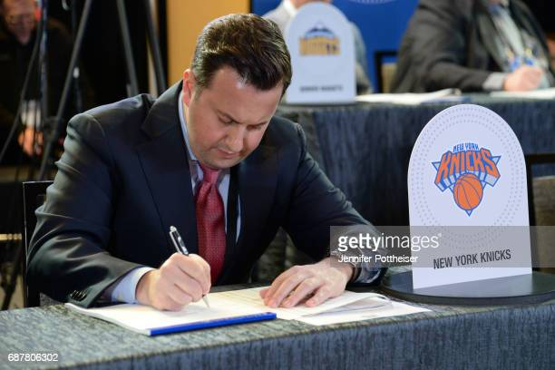 Jamie Mathews of the New York Knicks takes notes inside the lottery room during the 2017 NBA Draft Lottery at the New York Hilton in New York New...