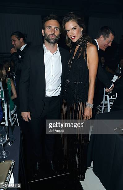 Jamie Mazur and model Alessandra Ambrosio attend amfAR's Inspiration Gala Los Angeles at Milk Studios on October 29 2015 in Hollywood California