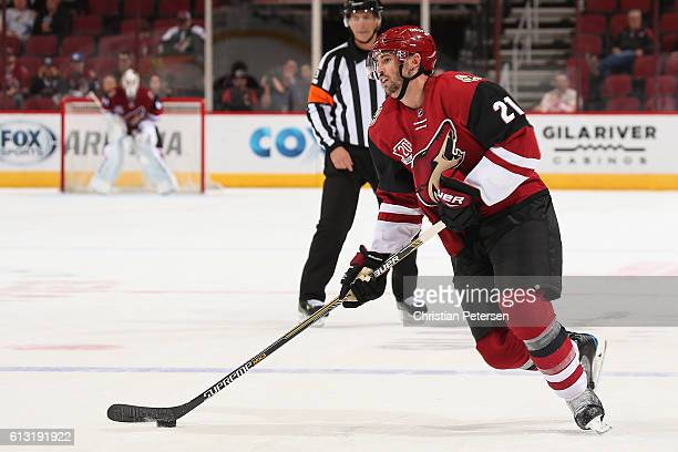 Jamie McBain of the Arizona Coyotes skates with the puck during the preseason NHL game against Anaheim Ducks at Gila River Arena on October 1 2016 in...