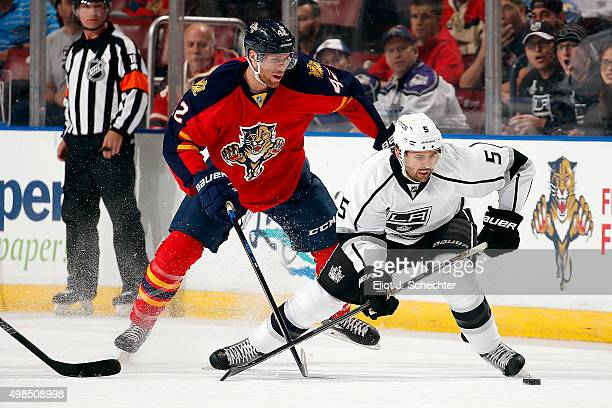 Jamie McBain of the Los Angeles Kings crosses sticks with Quinton Howden of the Florida Panthers during first period action at the BBT Center on...