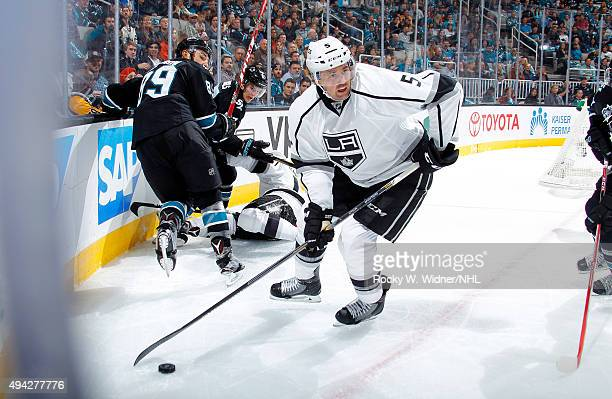 Jamie McBain of the Los Angeles Kings skates with the puck against the San Jose Sharks at SAP Center on October 22 2015 in San Jose California