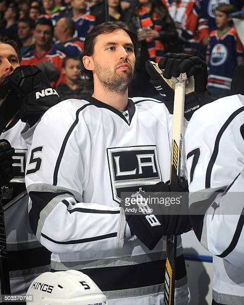 Jamie McBain of the Los Angeles Kings stands for the singing of the national anthem prior to the game against the Edmonton Oilers on December 29 2015...