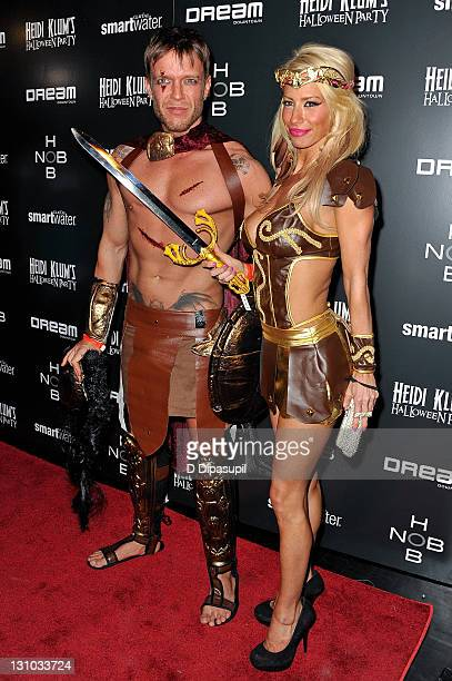 Jamie McCarthy and guest attend Heidi Klum's 12th annual Halloween party at the PHD Rooftop Lounge at Dream Downtown on October 31 2011 in New York...