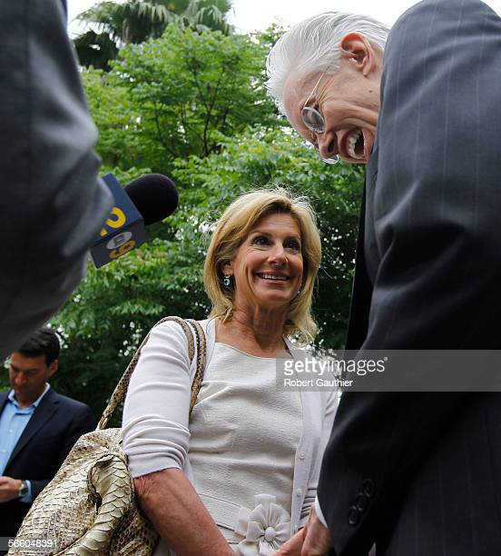 Jamie McCourt shares a laugh with her attorney Dennis Wasser as she talks with the media after Superior Court Judge Scott Gordon settled her and...