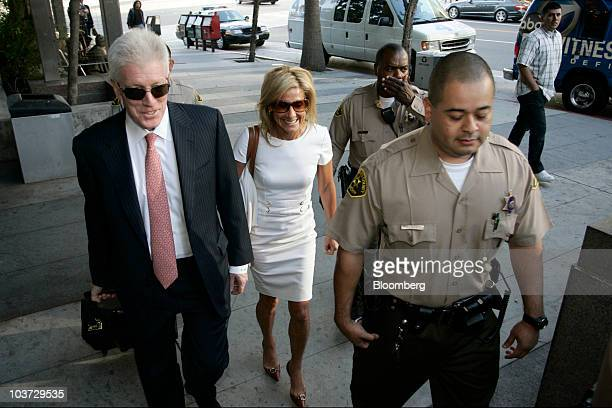 Jamie McCourt the estranged wife of Los Angeles Dodgers owner Frank McCourt center and her attorney Dennis Wasser left arrive at court in Los Angeles...