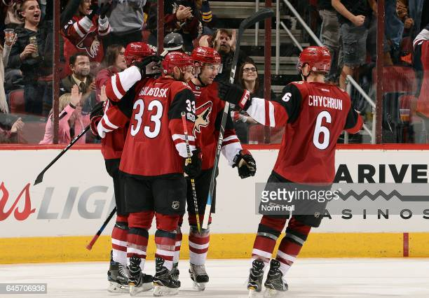 Jamie McGinn Alex Goligoski Jordan Martinook and Jakob Chychrun of the Arizona Coyotes celebrate McGinn's third period goal against the Buffalo...