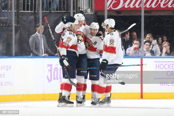 Jamie McGinn Nick Bjugstad Vincent Trocheck and Alex Petrovic of the Florida Panthers celebrate after scoring a goal in the first period against the...