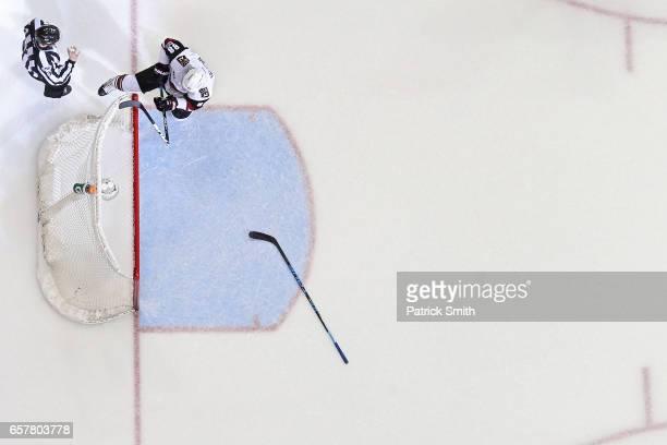 Jamie McGinn of the Arizona Coyotes breaks his stick over the crossbar after Daniel Winnik of the Washington Capitals scored an empty net goal during...