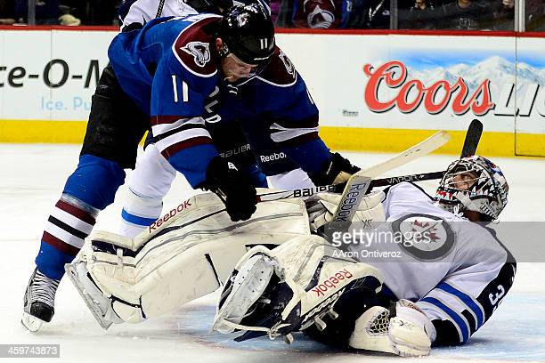 Jamie McGinn of the Colorado Avalanche collides with Al Montoya during the third period of action The Colorado Avalanche lost 21 to the Winnipeg Jets...