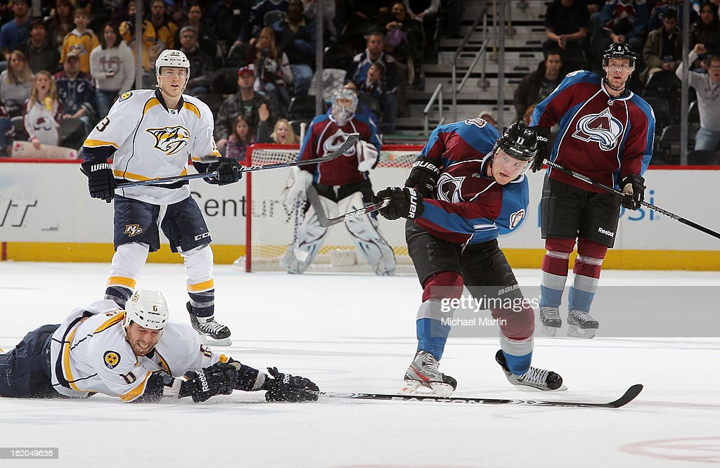 Jamie McGinn #11 of the Colorado Avalanche shoots on an open net as Shea Weber #6 of the Nashville Predators defends at the Pepsi Center on February 18, 2013 in Denver, Colorado. The Avalanche defeated the Predators 6-5.