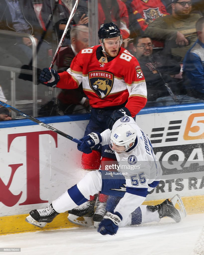 Jamie McGinn #88 of the Florida Panthers and Braydon Coburn #55 of the Tampa Bay Lightning collide behind the net during third period action at the BB&T Center on October 30, 2017 in Sunrise, Florida. The Lightning defeated the Panthers 8-5.