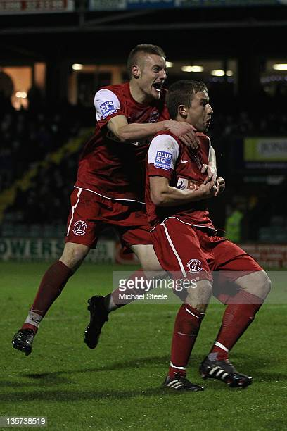 Jamie McGuire of Fleetwood Town celebrates scoring the opening goal with Jamie Vardy during the FA Cup Second Round Replay match between Yeovil Town...