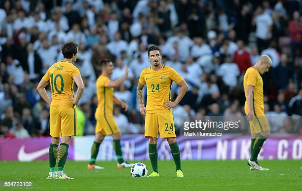 Jamie McLaren and Robbie Kruse of Australia look on after the second England goal during the International Friendly match between England and...