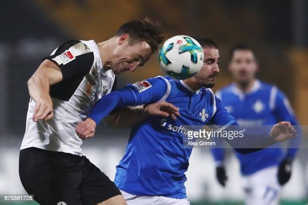 Jamie McLaren of Darmstadt is challenged by Tim Knipping of Sandhausen during the Second Bundesliga match between SV Darmstadt 98 and SV Sandhausen...