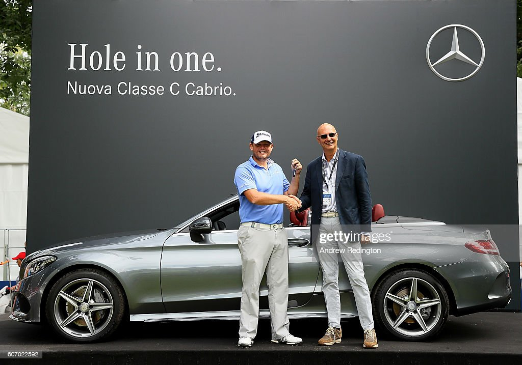 Jamie McLeary of Scotland poses with Cesare Salvini, Marketing Director of Mercedes Benz Italia and his new Mercedes C Class after hitting a hole in one on the 10th hole during the second round of the Italian Open at Golf Club Milano - Parco Reale di Monza on September 17, 2016 in Monza, Italy.