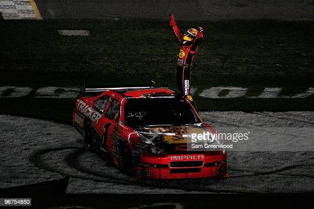 Jamie McMurray climbs on top of his Bass Tracker Chevrolet to celebrate winning the NASCAR Sprint Cup Series Daytona 500 at Daytona International...