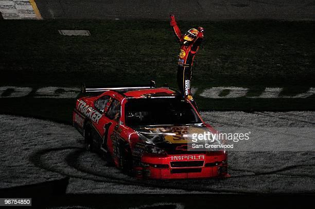 Jamie McMurray climbs on top of his Bass Tracker Chevrolet to celebrate winning the NASCAR Sprint Cup Series Daytona 500 at Daytona International...