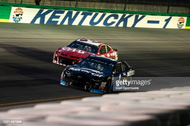 Jamie McMurray driver of the Arctic Cat Chevrolet passes Austin Dillon driver of the AAA Chevrolet in turn one in the Monster Energy NASCAR Cup...