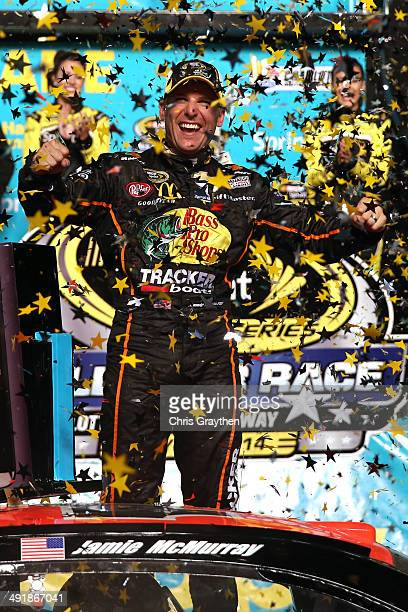 Jamie McMurray driver of the Bass Pro Chevrolet celebrates in victory lane after winning the NASCAR Sprint Cup Series Sprint AllStar Race at...