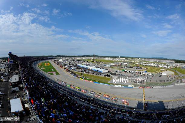 Jamie McMurray, driver of the Bass Pro Shops/Allstate Chevrolet, and Greg Biffle, driver of the 3M/National Breast Cancer Foundation Ford, lead the...