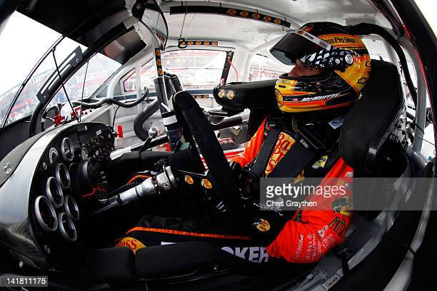 Jamie McMurray driver of the Bass Pro Shops/Allstate Chevrolet sits in his car during practice for the NASCAR Sprint Cup Series Auto Club 400 at Auto...