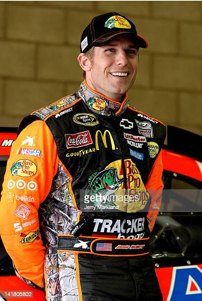 Jamie McMurray driver of the Bass Pro Shops/Allstate Chevrolet stands in the garage during practice for the NASCAR Sprint Cup Series Auto Club 400 at...
