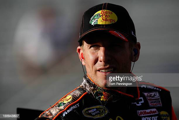 Jamie McMurray driver of the Bass Pro Shops/Allstate Chevrolet stands on the grid during qualifying for the NASCAR Sprint Cup Series AdvoCare 500 at...
