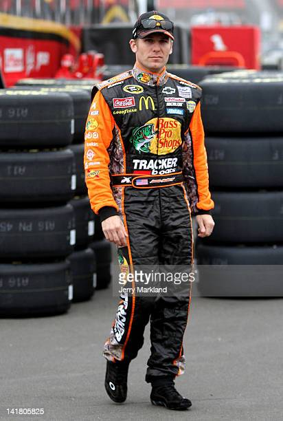 Jamie McMurray driver of the Bass Pro Shops/Allstate Chevrolet walks in the garage area during practice for the NASCAR Sprint Cup Series Auto Club...
