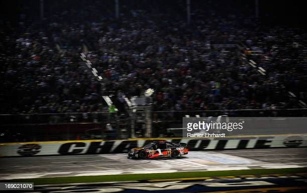 Jamie McMurray, driver of the Bass Pro Shops/National Wild Turkey Foundation Chevrolet, races past the finishline to win the NASCAR Sprint Cup...