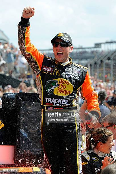 Jamie McMurray driver of the Bass Pro Shops/Tracker Boats Chevrolet celebrates winning the NASCAR Sprint Cup Series Brickyard 400 at Indianapolis...
