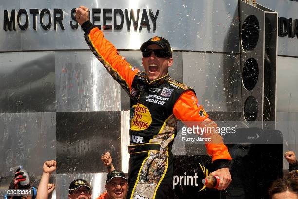 Jamie McMurray, driver of the Bass Pro Shops/Tracker Boats Chevrolet, celebrates winning the NASCAR Sprint Cup Series Brickyard 400 at Indianapolis...