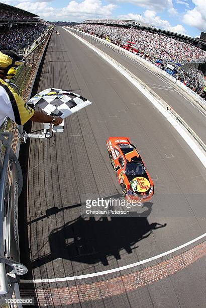 Jamie McMurray driver of the Bass Pro Shops/Tracker Boats Chevrolet crosses the finish line to win the NASCAR Sprint Cup Series Brickyard 400 at...
