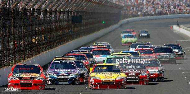 Jamie McMurray, driver of the Bass Pro Shops/Tracker Boats Chevrolet, and Kevin Harvick, driver of the Shell/Pennzoil Chevrolet, lead the pack after...