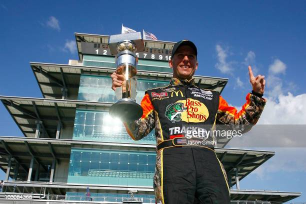 Jamie McMurray driver of the Bass Pro Shops/Tracker Boats Chevrolet poses with the Brickyard 400 Trophy after winning the NASCAR Sprint Cup Series...