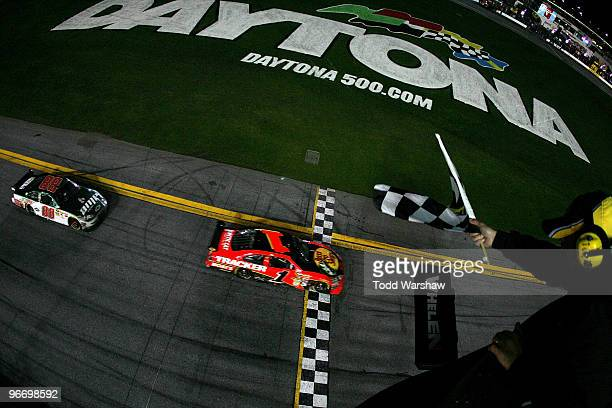Jamie McMurray driver of the Bass Pro Shops/Tracker Boats Chevrolet crosses the finish line to win the the NASCAR Sprint Cup Series Daytona 500...