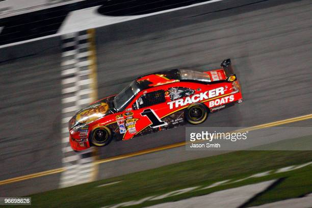 Jamie McMurray driver of the Bass Pro Shops/Tracker Boats Chevrolet crosses the finish line to win the the NASCAR Sprint Cup Series Daytona 500 at...