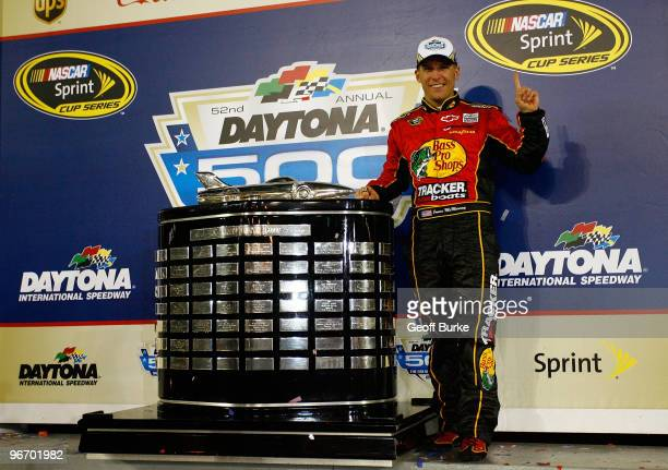 Jamie McMurray, driver of the Bass Pro Shops/Tracker Boats Chevrolet, celebrates in Victory Lane after winning the NASCAR Sprint Cup Series Daytona...